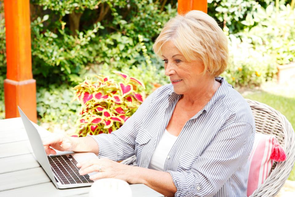 Senior woman paying bill online